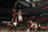 Miami Heat v Chicago Bulls - Game Five, Chicago, IL - MAY 26: Chris Bosh and Taj Gibson Photographic Print by Jonathan Daniel