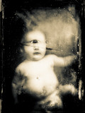 Sepia Photograph of Infant Cyclops Photographic Print by Clive Nolan