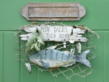Fish Tales Told Here Sign on the Cottage Door, Clovelly, Devon, UK Photographic Print by Nadia Isakova