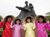 Vietnam, Ho Chi Minh City, Girls Dressed in Traditional Vietnamese Costume Photographic Print by Steve Vidler