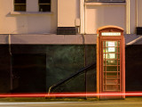 Night Shot of Uk Phonebox with Light Trails from Passing Car Photographic Print by Clive Nolan
