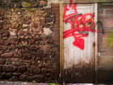 Derelict Door with Graffiti 5 Photographic Print by Clive Nolan