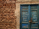 Blue Door with Arabic Writing, Luxor Town, Egypt Photographie par Clive Nolan