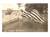 Woman on Shore Holding Flag Posters