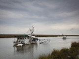 USA, Louisiana, Dulac, Bayou Fishing Boat by Lake Boudreaux Photographic Print by Walter Bibikow