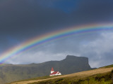 Rainbow over Church, Vik, Iceland Fotografie-Druck von Peter Adams