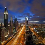 United Arab Emirates (UAE), Dubai, Sheikh Zayed Road Looking Towards the Burj Kalifa at Night Photographic Print by Gavin Hellier
