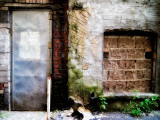 Filled in Derelict Doorway and Window Photographic Print by Clive Nolan