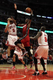 Miami Heat v Chicago Bulls - Game Five, Chicago, IL - MAY 26: Chris Bosh, Carlos Boozer and Luol De Photographic Print by Mike Ehrmann