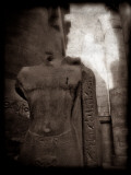 Statue of Unknown Person in the Great Hypostyle Hall, Karnak Temple, Egypt Photographic Print by Clive Nolan