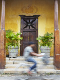 Man Cycling Past Doorway in Old Town of Galle Fort, Galle, Sri Lanka Photographic Print by Ian Trower