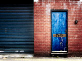 Derelict Door with Graffiti Photographic Print by Clive Nolan