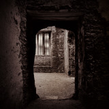 Doorway in Medieval Castle Ruins Photographic Print by Clive Nolan