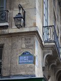 Street Sign and Building, Rive Guache, Paris, France Photographic Print by Jon Arnold