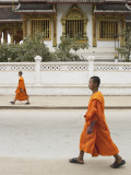 Monks Walking Down Street, Luang Prabang, Laos Photographic Print by Ian Trower