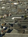 China, Yunnan Province, Lijiang, Lijiang Old Town Rooftops Photographic Print by Walter Bibikow