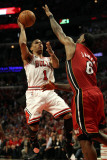 Miami Heat v Chicago Bulls - Game Five, Chicago, IL - MAY 26: Derrick Rose and LeBron James Photographic Print by Jonathan Daniel