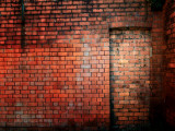 Filled in Derelict Door with Red Brickwork Photographic Print by Clive Nolan