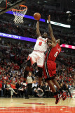 Miami Heat v Chicago Bulls - Game Five, Chicago, IL - MAY 26: Luol Deng and LeBron James Photographic Print by Mike Ehrmann