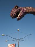 USA, Florida, Florida Panhandle, Panama City Beach, Dinosaur Statue at Miniature Golf Course Photographic Print by Walter Bibikow