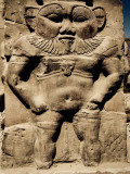 Statue of the Egyptian God Bes Photographic Print by Clive Nolan