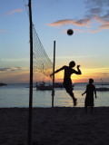 People Playing Volley Ball on White Beach at Sunset, Boracay, Philippines Photographic Print by Ian Trower