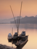 Boats on Mekong River at Sunset, Luang Prabang, Laos Photographic Print by Ian Trower