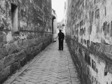 Man Standing in Narrow Alleyway, Tongli, Jiangsu, China Photographic Print by Ian Trower