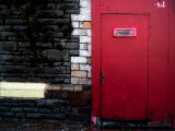 Derelict Red Door Photographic Print by Clive Nolan