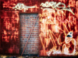 Filled in Derelict Door with Red Brickwork and Graffiti Photographic Print by Clive Nolan