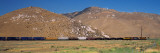 Freight Train Passing Near a Mountain Range, Tehachapi, California, USA Photographic Print