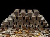Stack of Sliver Ingots And Pile of Coins Fotografisk trykk