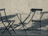 Table And Chairs at a Sidewalk Cafe, Colonia Del Sacramento, Uruguay Photographic Print
