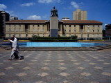 Statue of Jomo Kenyatta with a Courthouse in the Background, Nairobi Law Courts, Nairobi, Kenya Photographic Print