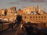 People on a Pier, Escollera Sarandi, Montevideo, Uruguay Photographic Print