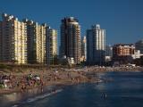 Tourists Enjoying on the Beach, Millennium Tower, Playa Mansa, Punta Del Este, Maldonado, Uruguay Photographic Print
