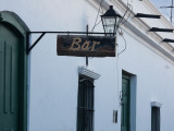 Low Angle View of a Bar Sign, Cachi, Salta Province, Argentina Photographic Print