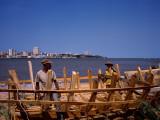 Two Men Making a Boat at the Coast, Delagoa Bay, Maputo, Mozambique Photographic Print