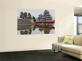 Matsumoto Castle with Moat, Stone Work and Red Wooden Bridge Wall Mural by Frank Carter