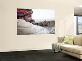 Camel Trader Overseeing Camels Wall Mural by April Maciborka