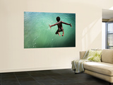 Torres Strait Islander Boy Leaping into the Sea, Seisia, Cape York Wall Mural by Tim Barker