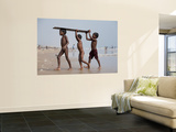 Three Boys Carrying Wooden Plank from Ocean Wall Mural by April Maciborka
