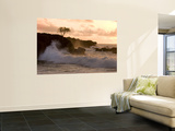 Sunset at Waimea Bay, with Waves Crashing Against Rocks Wall Mural by Linda Ching