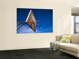 Basketball Net Against Blue Sky Wall Mural by Kimberley Coole