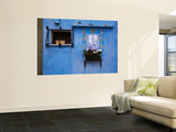 Blue Wall with Window and Religious Painting Wall Mural by Dennis Walton