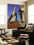 Saint Statue Decorating Corner of House with Tower of Church of Our Lady in Background Wall Mural by Bruce Bi