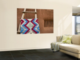 Woven Mat with Native American Indian Motif Against Mud-Brick Wall Wall Mural by Ray Laskowitz