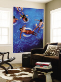 People Floating in Pool on Rubber Rings Wall Mural by Richard l'Anson