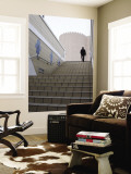 Businessman Ascending Staircase Wall Mural by Brent Winebrenner