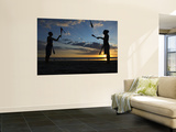 Silhouetted Jugglers on the Beach Wall Mural by Christian Aslund